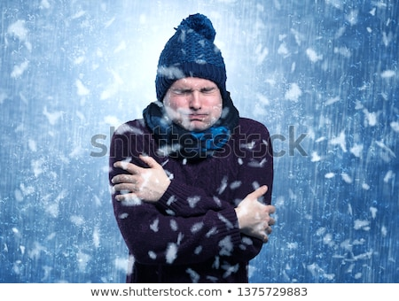 Handsome boy shivering at snowstorm concept Stock photo © ra2studio
