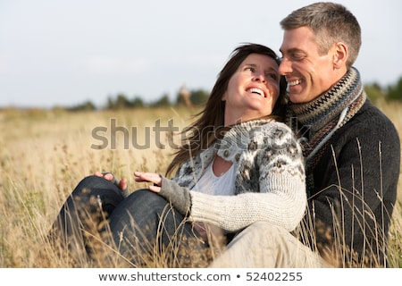Romantic Couple Relaxing Outdoors In Autumn Landscape Stock photo © monkey_business