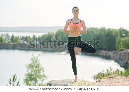 Békés fitt nő áll egy láb Stock fotó © pressmaster