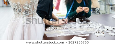 Young woman dressmaker or designer working as measuring for clot Stock photo © Freedomz