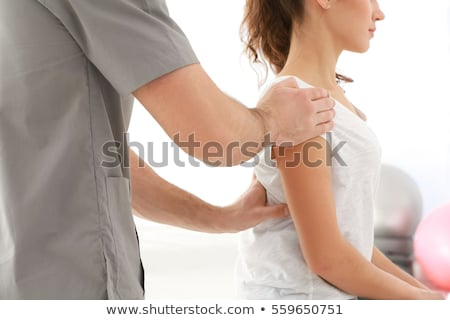 Physiotherapist Working With Patient In Clinic Stock photo © AndreyPopov