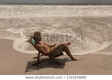 Shirtless jonge man hoed met behulp van laptop Stockfoto © wavebreak_media