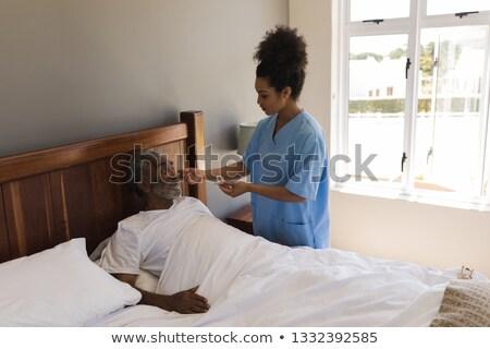 Elöl kilátás afroamerikai női orvos idős Stock fotó © wavebreak_media
