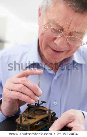 Senior Man Mending Clock Mechanism Stock photo © HighwayStarz