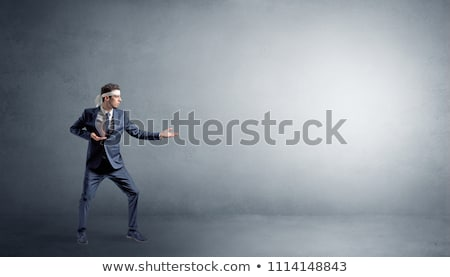 Small karate man fighting in an empty space Stock photo © ra2studio