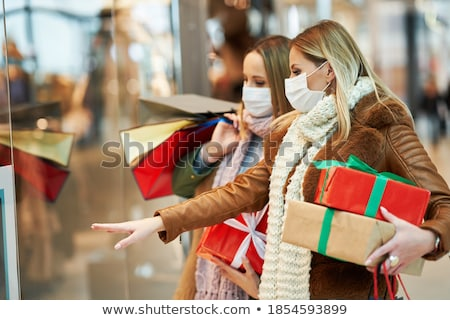 Young woman in Christmas mall with Christmas shopping. Beauty buy Christmas night shopping discounts Stock photo © galitskaya