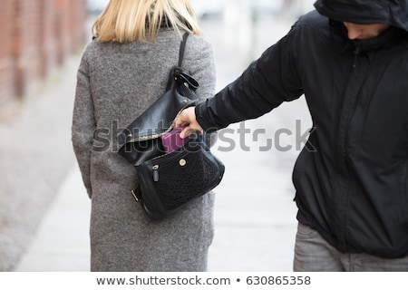 Person Stealing Purse From Handbag Stock photo © AndreyPopov