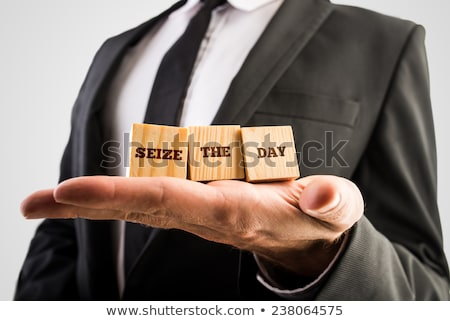 Hand of Businessman holding motivational message Stock photo © ra2studio