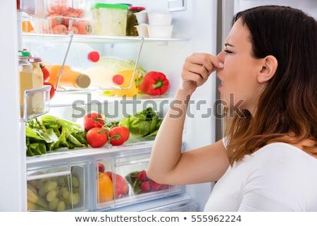 Lodówce złe zgniły zapach kobieta owoców Zdjęcia stock © AndreyPopov