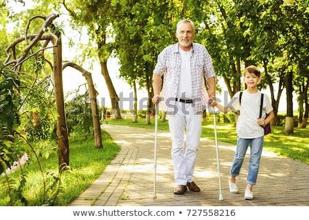Niepełnosprawnych człowiek spaceru kule kalekiego upośledzony pracownika Zdjęcia stock © AndreyPopov