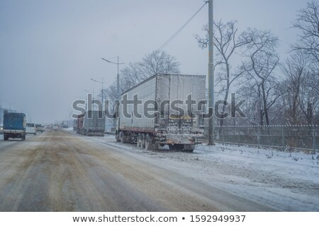 A lot of trucks that can not enter the city due to snowfall. Winter problems on the road Stock photo © galitskaya