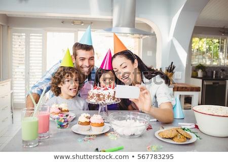 Imagem adulto mulher bolo de aniversário Foto stock © deandrobot