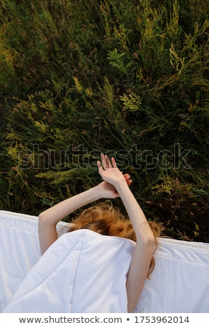 Beautiful female laying on the flower field stock photo ...