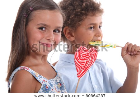 two skittish kids with lollypops stock photo © photography33
