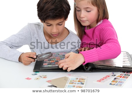 Children stamp collecting Stock photo © photography33