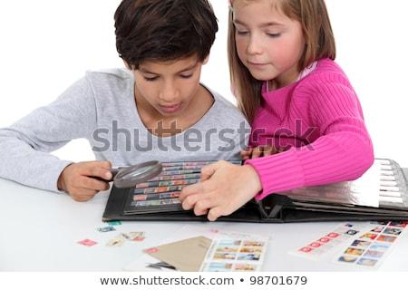 Stock photo: Children stamp collecting