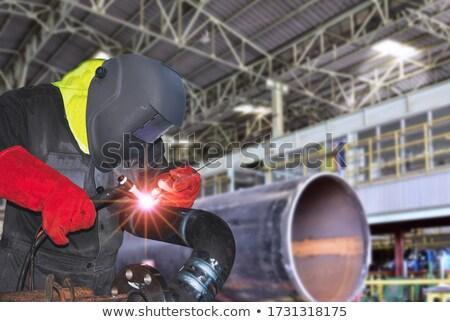 Homem soldagem tubo trabalhar espaço azul Foto stock © photography33
