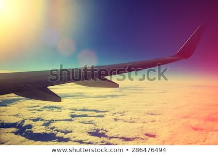 napfelkelte · repülőgépek · szárny · ablakok · felhőkép · üzlet - stock fotó © vichie81