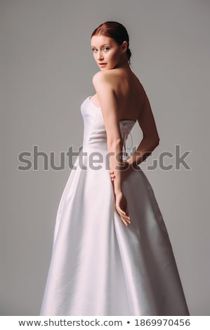 Pretty bride in white nuptial dress posing in studio Stock photo © gromovataya
