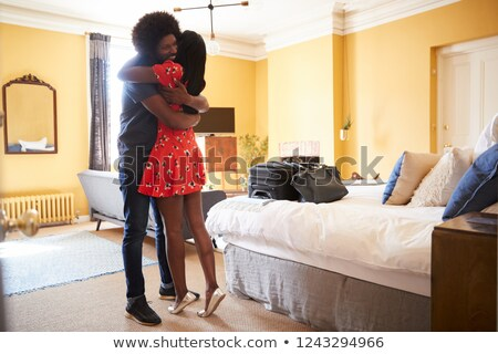 clothed couple hugging on a bed stock photo © photography33