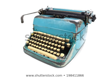 Antique typewriter against a crisp white backdrop. Stock photo © ozaiachin