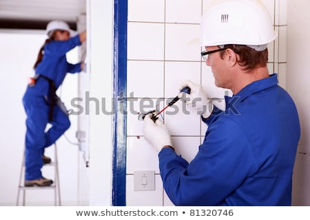 female electrician installing a power point stock photo © photography33