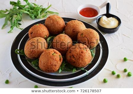 Stock photo: Raw fish on ball of rice
