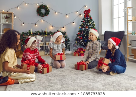 girls giving their friend a present in a living room stock photo © wavebreak_media