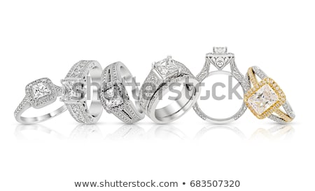 set of rings with precious stones on a white background stock photo © yurkina