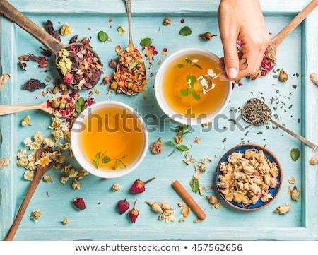 Orgânico camomila chá medicinal rústico escavar Foto stock © PixelsAway