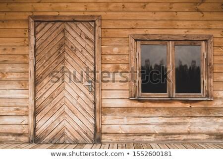 Kunyhó ajtó kék virágok fa vidék Stock fotó © diabluses