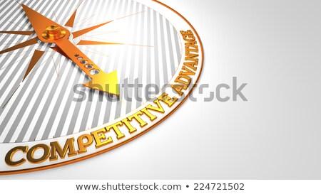 Competitivo ventaja blanco dorado brújula aguja Foto stock © tashatuvango