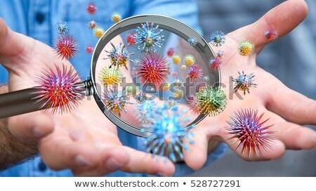 ebola through magnifying glass stock photo © tashatuvango