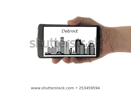 Vrouwelijke hand mobiele telefoon Detroit skyline geïsoleerd Stockfoto © compuinfoto