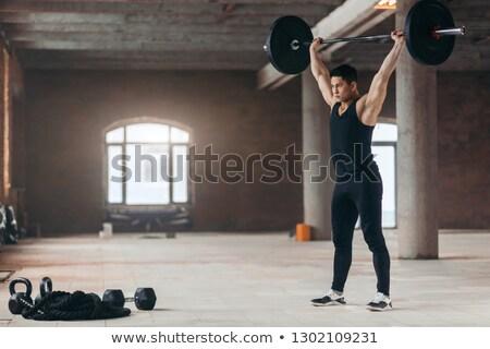 筋肉の 男 立って バーベル 黒 ボディ ストックフォト © deandrobot