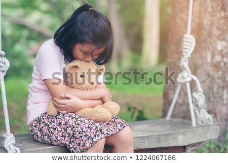 beautiful girl draging toy bear Stock photo © PetrMalyshev