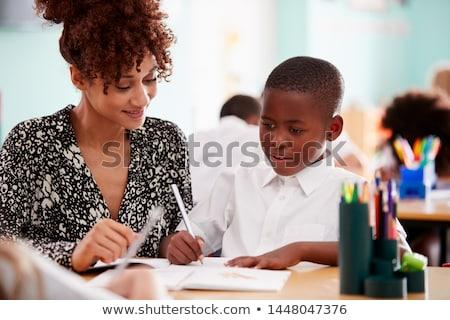 tanár · iskolás · dolgozik · asztal · együtt · általános · iskola - stock fotó © wavebreak_media