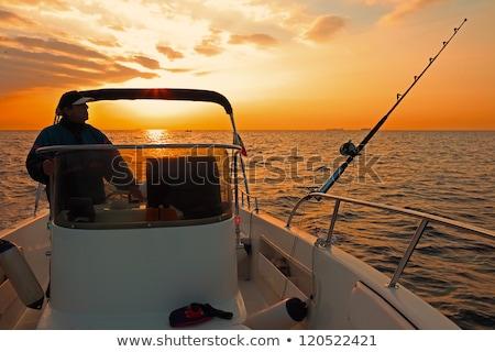 Motor boat in the ocean in evening sunlight Stock photo © epstock