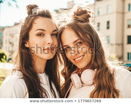 Szexi nő néz kamera szexi fiatal nő hosszú haj Stock fotó © NeonShot