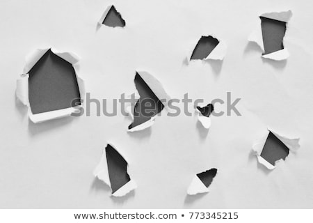 Black hole in white paper Stock photo © cherezoff