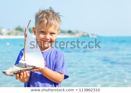 boy with toy ship in hands ashore Stock photo © Paha_L