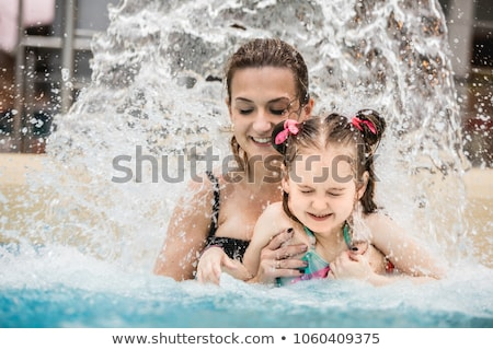 smiling beautiful woman and little girl bathes in pool under wat stock photo © paha_l