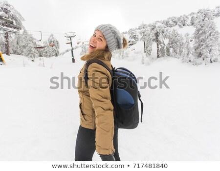 Laughing vivacious young women at a ski resort Stock photo © dash