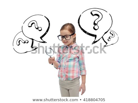 little girl in eyeglasses with magnifying glass stock photo © dolgachov