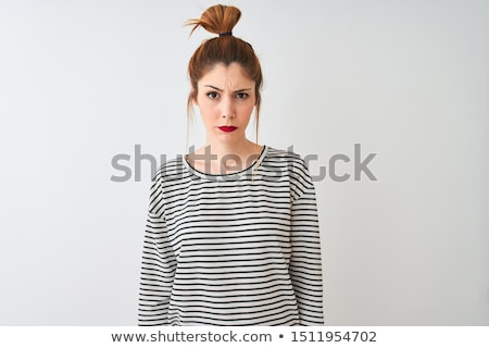 Thoughtful frowning young woman standing and thinking Stock photo © deandrobot