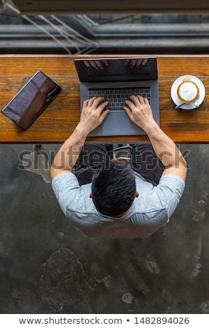 Empresário datilografia computador portátil caucasiano adulto Foto stock © diego_cervo