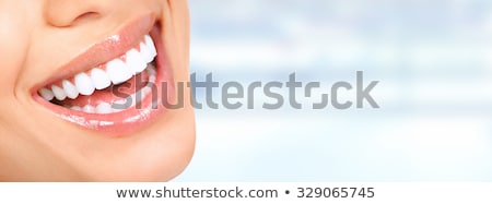 Dental health care, healthy tooth and tooth with caries Stock photo © Tefi
