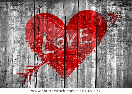 heart pierced by an arrow with word love on grunge background stock photo © ptichka