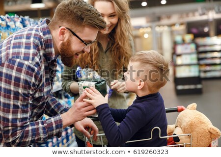 Side view of man giving convenience food to the boy Stock photo © deandrobot