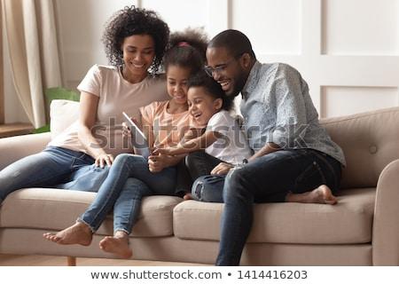 mutlu · aile · dizüstü · bilgisayar · dijital · tablet · oturma · kanepe - stok fotoğraf © diego_cervo